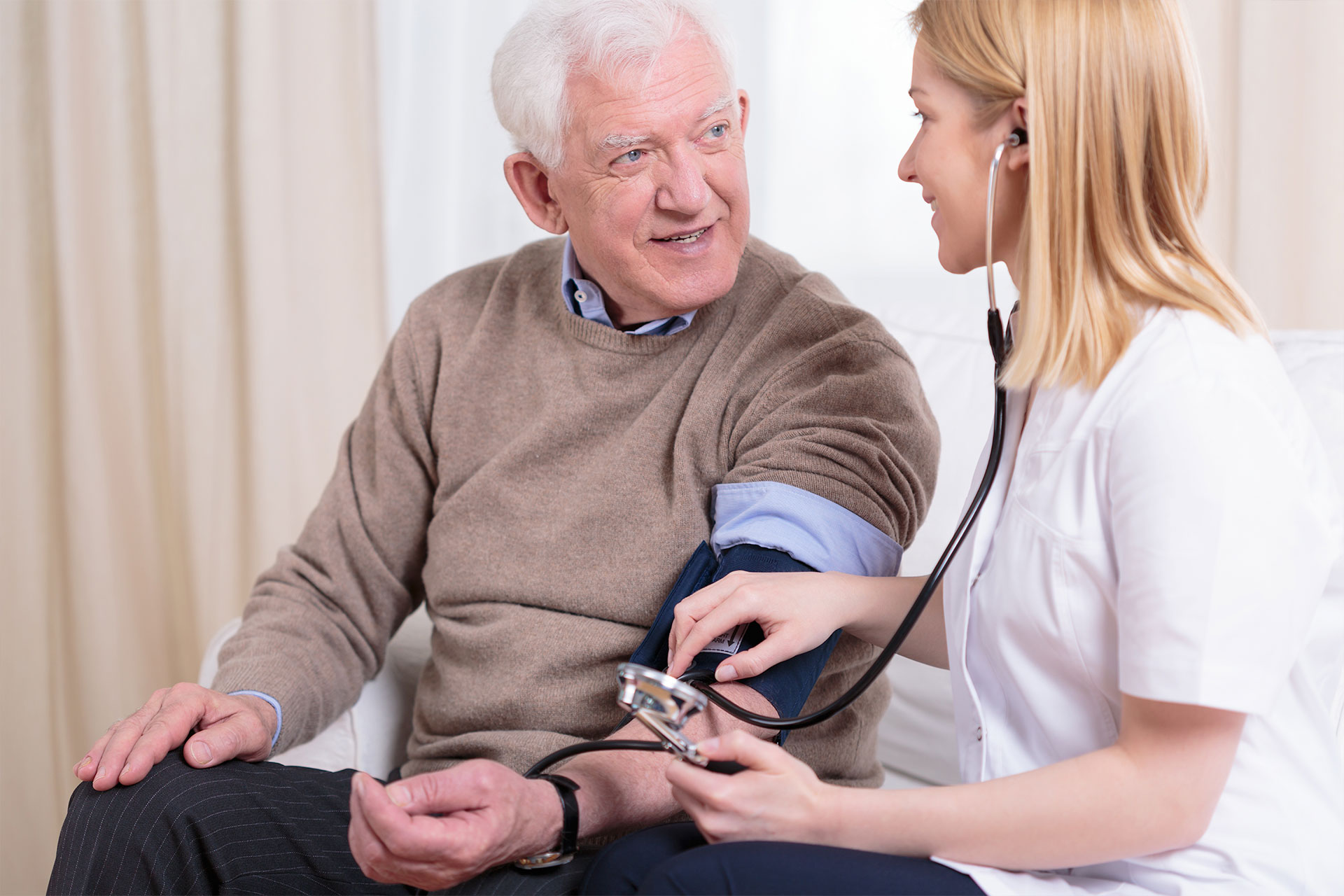 nurse caring for patient by checking for high or unhealthy cholesterol