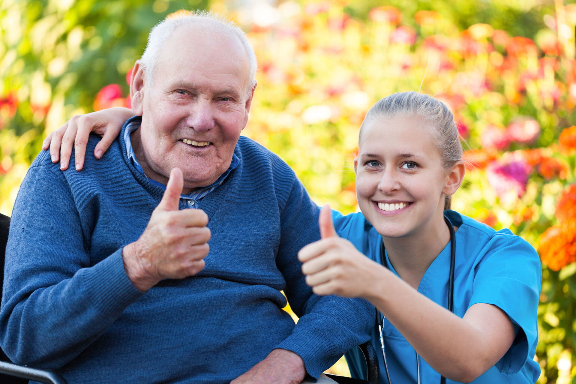 Nurse and patient giving a thumbs up to getting vaccinated
